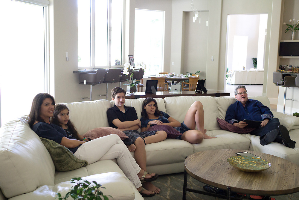 MAY 23, 2015---BOCA RATON, FLORIDA----<br /> The Zietz family sits around watching the show Shark Tank in the Boca Raton house. From left; Rachel, Morgan, 9, Jordan, 13, Rachel, 14 and Sam. Parents Sam and Rachel have instilled in their children the entrepreneurial spirit and it has paid off. Older children Rachel, 14, and her brother Jordan, 13, each has their own business and they're thriving.