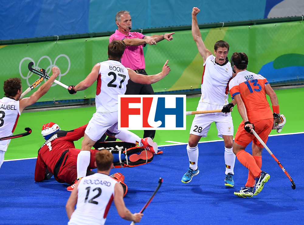 Belgium's Jerome Truyens (2nd R) celebrates a goal with teammates during the men's semifinal field hockey Belgium vs Netherlands match of the Rio 2016 Olympics Games at the Olympic Hockey Centre in Rio de Janeiro on August 16, 2016.  / AFP / MANAN VATSYAYANA        (Photo credit should read MANAN VATSYAYANA/AFP/Getty Images)