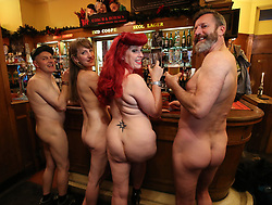 NOTE NUDITY (left to right) Davidos Pass, Maria Beadell, Emma Ruth and pianist Luke Meredith before taking part in London's first nudist pub singalong at the Coach And Horses in Soho.