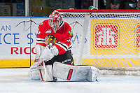 KELOWNA, CANADA - APRIL 25: Corbin Boes #30 of the Portland Winterhawks makes a save against the Kelowna Rockets on April 25, 2014 during Game 5 of the third round of WHL Playoffs at Prospera Place in Kelowna, British Columbia, Canada. The Portland Winterhawks won 7 - 3 and took the Western Conference Championship for the fourth year in a row earning them a place in the WHL final.  (Photo by Marissa Baecker/Getty Images)  *** Local Caption *** Corbin Boes;