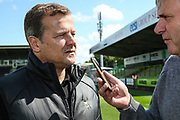 Forest Green Rovers manager, Mark Cooper being interviewed before the match during the EFL Sky Bet League 2 match between Forest Green Rovers and Grimsby Town FC at the New Lawn, Forest Green, United Kingdom on 17 August 2019.