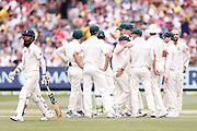 Moeen Ali walks off in-front of the Australian team after being dismissed by Nathan Lyonduring day three of the Australia v England fourth test at the Melbourne Cricket Ground, Melbourne, Australia on 28 December 2017. Photo by Mark  Witte.
