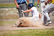 Coeur d'Alene Lumberman Derek Priano slides safe into home during Sunday's championship American Legion game against the Lewis-Clark Twins.