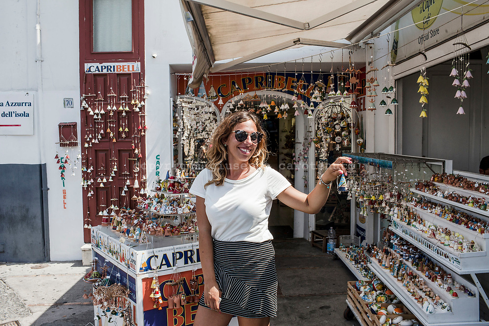 "04 August 2017, Capri Italy - A young souvenir merchant in the port of ""Marina Grande"" in the island of Capri."