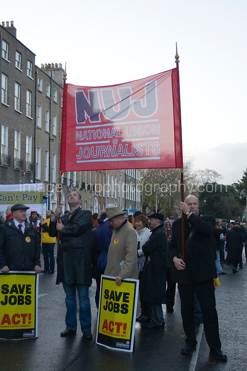 The National Union of Journalists (NUJ) amongst protesters marching in Dublin Ireland as part of a campaign organised by the Irish Congress of Trade Unions