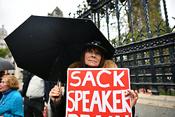 © Licensed to London News Pictures. 21/10/2019. London, UK. A pro Brexit supporter holds up a sign calling for speaker John Bercow to be sacked, outside the Houses of parliament in Westminster, London. Last week Parliament sat on a Saturday for the first time since 1982, but failed to vote on Boris Johnson's new Brexit deal. Photo credit: Ben Cawthra/LNP