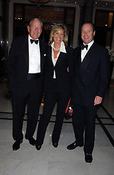 Left to right, NEIL DURDEN-SMITH and JAMES & SUSIE BUCHANAN she is the daughter of Nicholas Parsons at the annual Ascot charity auction dinner this year in aid of The Princes Trust held at the Hyatt Churchill Hotel, Portman Square, London on 21st September 2004.<br />
