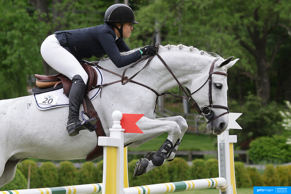 NORTH SALEM, NEW YORK - May 21: Victoria Press riding Cayenne 140 in action during The $15,000 Under 25 T & R Development Grand Prix at the Old Salem Farm Spring Horse Show on May 21, 2016 in North Salem, New York. (Photo by Tim Clayton/Corbis via Getty Images)