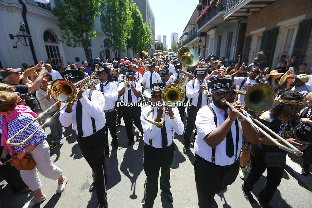 The Kinfolk Brass Band performs during a second line following the funeral service for NFL New Orleans Saints owner and NBA New Orleans Pelicans owner Tom Benson in New Orleans, Friday, March 23, 2018. Benson died last Thursday at the age of 90. (AP Photo/Derick Hingle)