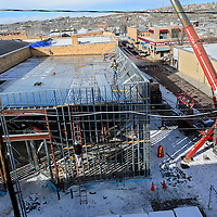 010215       Cable Hoover<br /> <br /> Snow surrounds the worksite of the El Morro Theatre expansion project in downtown Gallup Friday. Recent weather conditions have pushed back the expected completion date of the project.