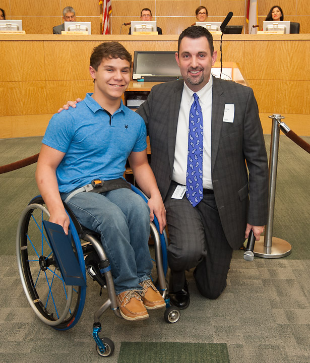 HSPVA principal Dr. Robert Allen, left, and Abraham Hausmann-Weiss, right, pose for a photograph after Hausmann-Weiss was recognized for athletic and academic achievement during a Board of Education meeting, May 9, 2013.