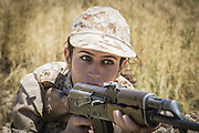 Sulaymaniyah, Iraq - <br /> <br /> Female Fighters of The Peshmerga<br /> As ISIS has swept across northern Iraq, they have become known for their atrocities towards women. However, there's a group of women that aren't preparing to flee ISIS but instead are preparing to meet them with their AK-47s. The 2nd Peshmerga, are a battalion of Kurdish fighters &sbquo;&Auml;&igrave; and they just happen to be an all-female soldiers. They're front line troops, some of whom have been fighting for years, and they are eager to face ISIS. Dressed in army fatigues and armed with rifles, they are ready to lay down their lives to protect the Kurdish homeland against the threat of ISIS. They carry out training exercises and look no different from other Kurdish soldiers - except for a hint of makeup on some faces and long hair escaping from their caps. The 2nd Battalion consists of 550 mothers, sisters and daughters and was formed in 1996. Over the past month, they have moved into disputed areas abandoned by Iraqi security forces during the Isis advance. They have also recently seized control of oil production facilities at Bai Hassan and Kirkuk - the female Peshmerga will now be part of a mission to secure the city and its surrounding oil fields.<br /> <br />  A woman Peshmerga of the 2nd Battalion takes part in a military exercise.<br /> &copy;Excluisvepix Media