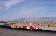John Surtees (7 Lola, winner of this race and defending '66 series champion) and Bruce McLaren (4 McLaren, '67 series champion) in 1967 Stardust Can-Am at Las Vegas; PHOTO BY Pete Lyons 1967 / © 2014 Pete Lyons/www.petelyons.com