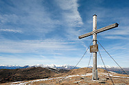 Large cross on the summit of Millstätter Alpe (2091m), with Hohe Tauern mountains in the distance. Alpe Adria Trail, Nockberge mountains. Carinthia, Austria (October 2015) © Rudolf Abraham