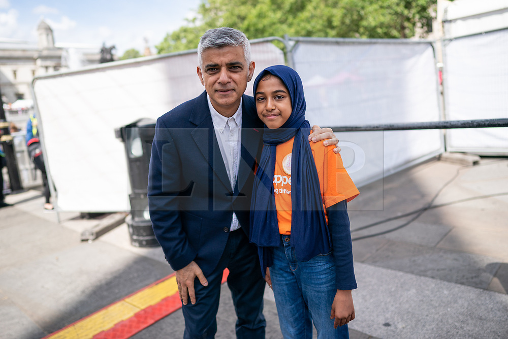 © Licensed to London News Pictures. 08/06/2019. London, UK. Mayor of London Sadiq Khan takes a picture with a girl after speaking at an event in Trafalgar Square to celebrate Eid ul-Fitr - the breaking of the fast. The festival marks the end of Ramadan, a holy month in the Muslim calendar when Muslims fast during the hours of daylight. This year, Eid occurred on Tuesday 4 June. Photo credit : Tom Nicholson/LNP
