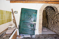 GANGI, ITALY - 30 MAY 2015: An old door belonging to an abandoned house is here in the kitchen area after the restoration, in Gangi, Italy, on May 30th 2015. Gangi is a town with a population of 7,000 between Palermo and Catania, in the centre of Sicily, whose local administration is giving away abandoned houses of the historical centre for free. The Mayor of Gangi Giuseppe Ferrarello conceived the initiative of giving houses for free as a means to diversify the local economy - primarily dependent on agriculture and animal husbandry - by boosting tourism-related activities, and consequently counteract the phenomenon of depopulation that is typical of many small Italian towns where employment possibilities have been on a downward trajectory for years. The renovations of the assigned homes have also given work to local artisans.