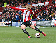 Jake Bidwell crossing the ball during the Sky Bet Championship match between Brentford and Millwall at Griffin Park, London, England on 21 March 2015. Photo by Matthew Redman.