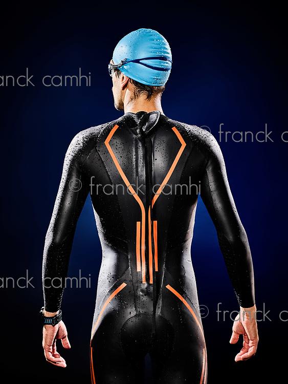 one caucasian  man triathlon ironman swimmer swimming   isolated