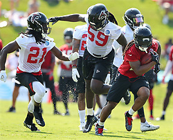 July 27, 2017 - Flowery Branch, GA, USA - From left, Atlanta Falcons cornerback Desmond Trufant and linebacker De'Vondre Campbell cover running back Devonta Freeman on a pass reception during the first day of team practice at training camp on Thursday, July 27, 2017, in Flowery Branch, Ga. (Credit Image: © Curtis Compton/TNS via ZUMA Wire)