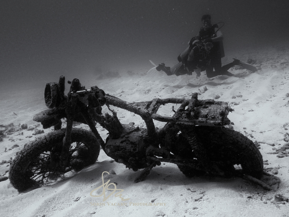 The unlikely sight of a sunken Harley surprises a couple of scuba divers exploring a reef off the Yucatan Peninsula