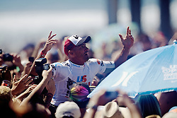 HUNTINGTON BEACH, California/USA (Sunday,Aug 7, 2011) 0-Time ASP World Champion Kelly Slater (Cocoa Beach, FL), 39, is carried on his fans shoulders after winning  the U.S. Open of Surfing 2011. Photo: Eduardo E. Silva.