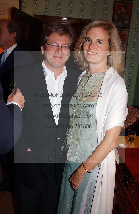 JOHN PAWSON and his wife CATHERINE at a party for interior designer Katherine Ireland held at Marks club, 46 Charles Street, London W1 on 27th September 2004.<br />