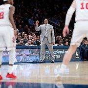 January 9, 2018, New York, NY : Georgetown head coach Patrick Ewing, left, signals to his team from the sideline during Tuesday night's matchup between the Hoyas and Red Storm at the Garden. In something of a rematch of their 1985 contest, Basketball greats Patrick Ewing and Chris Mullin returned to Madison Square Garden on Tuesday night to face off as coaches with their respective Georgetown and St. John's teams.  CREDIT: Karsten Moran for The New York Times