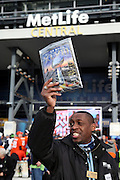 A vendor sells copies of game programs before the NFL Super Bowl XLVIII football game between the Seattle Seahawks and the Denver Broncos on Sunday, Feb. 2, 2014 in East Rutherford, N.J. The Seahawks won the game 43-8. ©Paul Anthony Spinelli