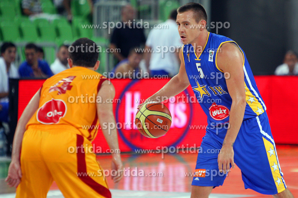 Aleksej Nesovic of BiH and Dimitar Mirakovski of Macedonia at friendly match between Macedonia and BIH for Adecco Cup 2011 as part of exhibition games before European Championship Lithuania on August 6, 2011, in SRC Stozice, Ljubljana, Slovenia. (Photo by Urban Urbanc / Sportida)