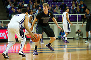 FORT WORTH, TX - JANUARY 7: Will Spradling #55 of the Kansas State Wildcats defends against Kyan Anderson #5 of the TCU Horned Frogs on January 7, 2014 at Daniel-Meyer Coliseum in Fort Worth, Texas.  (Photo by Cooper Neill/Getty Images) *** Local Caption *** Will Spradling