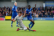 AFC Wimbledon defender Paul Osew (37) getting fouled during the EFL Sky Bet League 1 match between AFC Wimbledon and Portsmouth at the Cherry Red Records Stadium, Kingston, England on 19 October 2019.