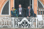 David Warner of Australia standing on the team balcony looking depressed as he looks out acrossthe  Lords outfield as the rain continues to fall during the International Test Match 2019 match between England and Australia at Lord's Cricket Ground, St John's Wood, United Kingdom on 14 August 2019.