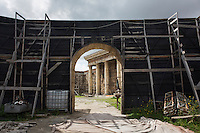 "ROME, ITALY - 30 MARCH 2015: A Roman temple of the set of ""Rome"", the British-American-Italian broadcasted between 2005 and 2007 on HBO, BBC Two and RaiDue, is seen here from behind the scenes in Cinecittà in Rome, Italy, on March 30th 2015.<br /> <br /> Italy instated a special 25% tax credit for film productions in 2010. The industry then lobbied to remove the credit's cap, and last July, Italy lifted its tax credit limit from €5 million per movie to €10 million per company per year. <br />  <br /> Cinecittà, a large film studio in Rome, is considered the hub of Italian cinema. The studios were founded in 1937 by Benito Mussolini as part of a scheme to revive the Italian film industry. In the 1950s, the number of international productions being made here led to Rome being dubbed as the ""Hollywood on the Tiber"". In the 1950s, Cinecittà was the filming location for several large American film productions like Ben-Hur, and then became the studio most closely associated with Federico Fellini.<br /> After a period of near-bankruptcy, the Italian Government privatized Cinecittà in 1997, selling an 80% stake.<br /> <br /> Currently Ben-Hur and Zoolander 2 are booked into Cinecittà Studios."