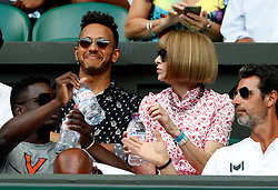 Lewis Hamilton and Anna Wintour in the players box on centre court on day twelve of the Wimbledon Championships at the All England Lawn Tennis and Croquet Club, Wimbledon.