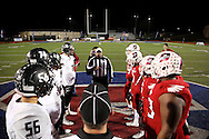 Players meet at midfield for the coin toss before the TAPPS Division I state championship game on Saturday, Dec. 3, 2016 at Panther Stadium in Hewitt, Texas. Bishop Lynch High School won 21-17. (Photo by Kevin Bartram)