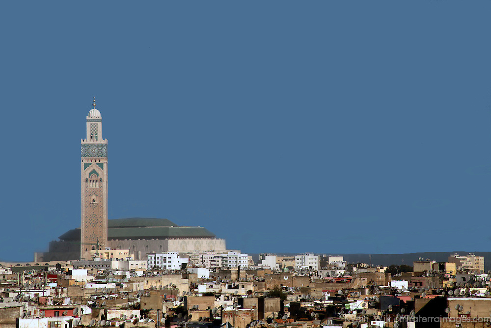 Africa, Morocco, Casablanca. Hassan II Mosque towers over the city of Casablanca.