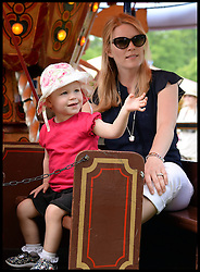 Autumn Phillips rides on the a fair rides with her daughter Isla at the Windsor Horse Show. Windsor, United Kingdom. Saturday, 17th May 2014. Picture by Andrew Parsons / i-Images