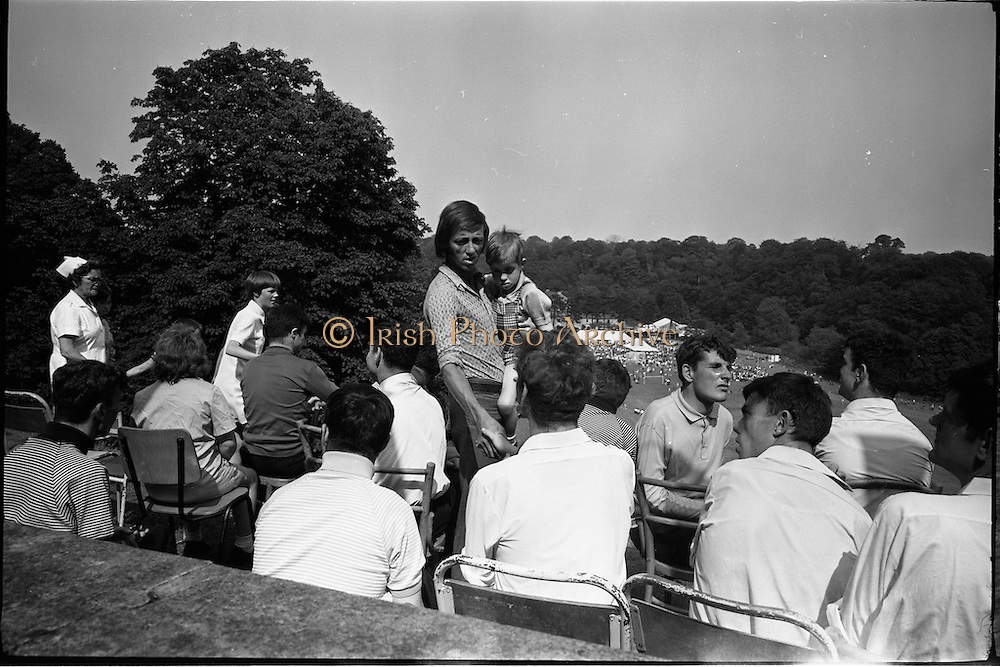 15/07/1972<br /> 07/15/1972<br /> 15 July 1972<br /> Muhammad Ali at Stewarts Hospital Fete, Palmerstown, Dublin. Some of the crowd that came to see the great boxer, including singer Dicky Rock (standing with child).