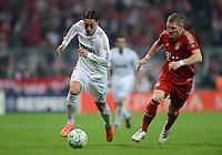 FUSSBALL   CHAMPIONS LEAGUE  HALBFFINAL HINSPIEL   2011/2012      FC Bayern Muenchen - Real Madrid          17.04.2012 Mesut Oezil (li, Real Madrid) gegen Bastian Schweinsteiger (re, FC Bayern Muenchen)