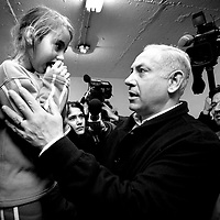 Benjamin Netanyahu talk to a young girl while touring bomb shelters in Ashdod during Cast Lead Operation in Gaza, December 2008.
