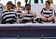"01 NOVEMBER 1999  - PHOENIX, ARIZONA, USA: Members of the women chain gang in Maricopa County, Phoenix, AZ, weep  while they bury a homeless person in the county's ""Potter's Field"" or cemetery for the indigent. Maricopa county sheriff Joe Arpaio claims to have the only women's chain gang in the United States. He has been criticized for the chain gang but claims to be an ""equal opportunity incarcerator."" He has said that if puts men on a chain gang he will also put women on a chain gang. The women are prisoners in the county jail and volunteer for duty on the chain gang because it gets them out of the jail for six hours a day. The chain gang also buries the county's homeless and indigents.   © Jack Kurtz  WOMEN   PRISON   CIVIL RIGHTS  SOCIAL ISSUES    POVERTY"