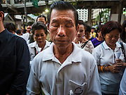 24 AUGUST 2015 - BANGKOK, THAILAND: A man prays at a memorial service for victims of the Erawan Shrine bombing. One week after the a bomb at the Erawan Shrine in the center of Bangkok killed dozens and hospitalized scores of people, police have not made any arrests. Police bomb sniffing dogs have been deployed to malls and markets around Bangkok. There was a large memorial service sponsored by businesses close the bomb site Monday evening.    PHOTO BY JACK KURTZ