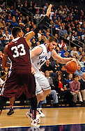 St. Louis  University basketball player Brian Conklin (14) drives to the basket past Fordham University's Chris Gaston (33) during the first half of the Billikens' 66-46 Atlantic 10 win over the Rams at Chaifetz Arena on the St. Louis University campus Saturday, Feb. 18, 2012 in St. Louis. Photo © copyright 2012 Sid Hastings.