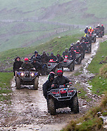 A convoy of quadsi in the pouring rain during a field day for the Ahuwhenua Trophy - BNZ Maori Excellence in Sheep and Beef Farming competition...John Cowpland.Alphapix.PO Box 876.Napier.New Zealand..Phone +64 6 8445334.Mobile + 64 272533464..info@alphapix.co.nz..www.alphapix.co.nz..Any images are copyright of Alphapix / John Cowpland..No images may be stored, manipulated, distributed or altered in any way, without written permission or license to do so.