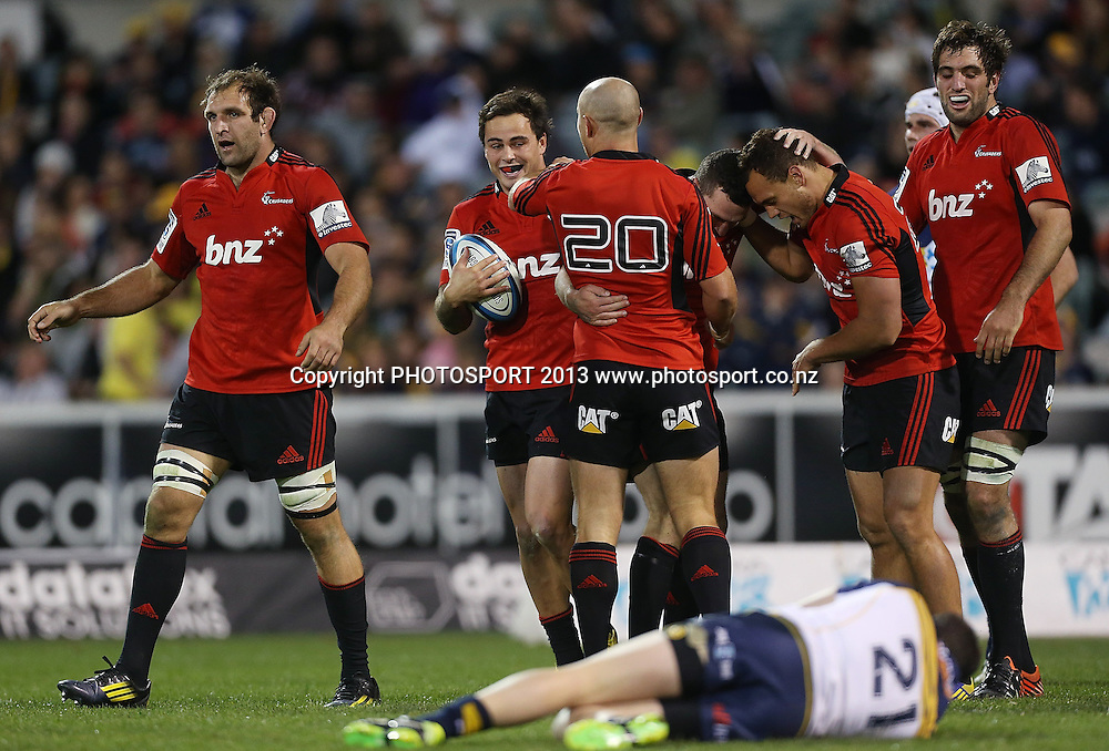 Crusaders' Israel Dagg celebrates scoring a try with teammates.  Brumbies v Crusaders. 2013 Investec Super Rugby Season. Canberra Stadium, Canberra, Australia.  Sunday 5 May 2013. Photo: Mark Metcalfe/Photosport.co.nz
