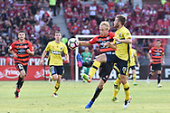 February 12, 2017: Western Sydney Wanderers midfielder Mitch NICHOLS (6) gets the ball past Central Coast Mariners Liam ROSE (16) at Round 19 of the 2017 Hyundai A-League match, between Western Sydney Wanderers and Central Coast Mariners played at Spotless Stadium in Sydney.