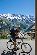 Bicyclist in Mürren, Lauterbrunnen Valley, Switzerland, the Alps, Europe.