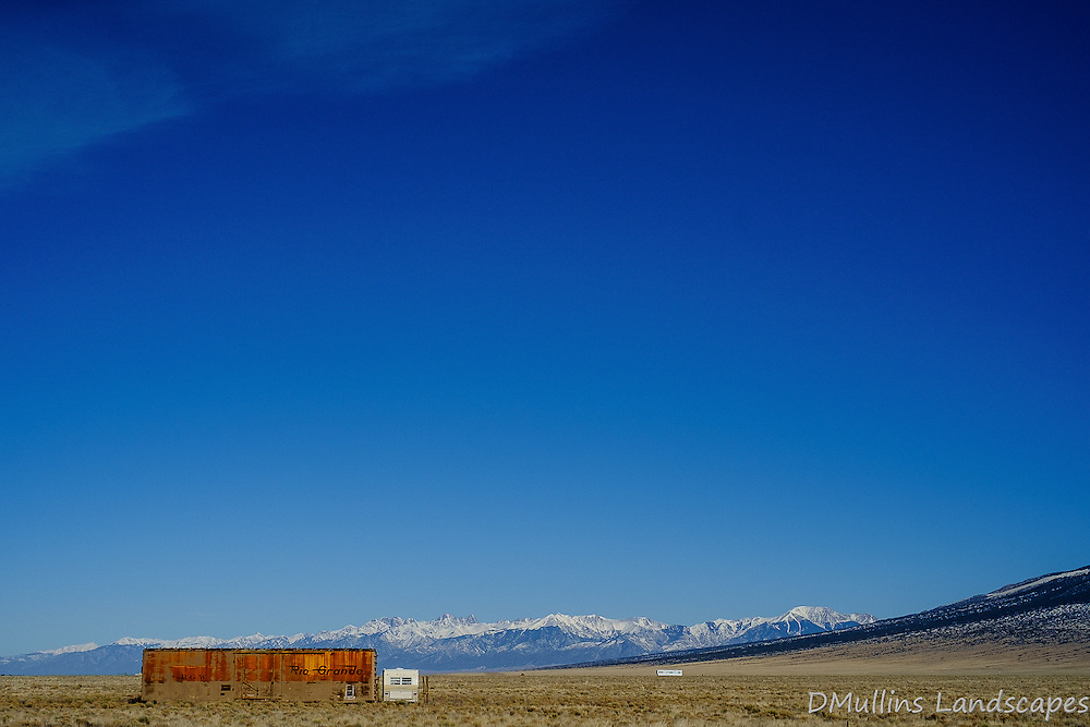 Rio Grande train car sitting in a field<br /> <br /> Available Sizes: 7x11, 13x19, 16x24