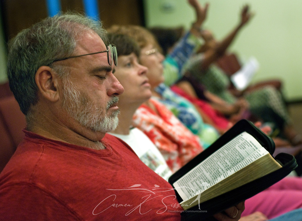 Gary Baynes reads his Bible during a Community Crisis prayer service May 26, 2010 at First Baptist Church in Chalmette, La. Nearly 100 coastal residents attended the service to pray for protection, comfort, guidance, and mercy as BP continues to battle the oil spill in the Gulf of Mexico. (Photo by Carmen K. Sisson/Cloudybright)