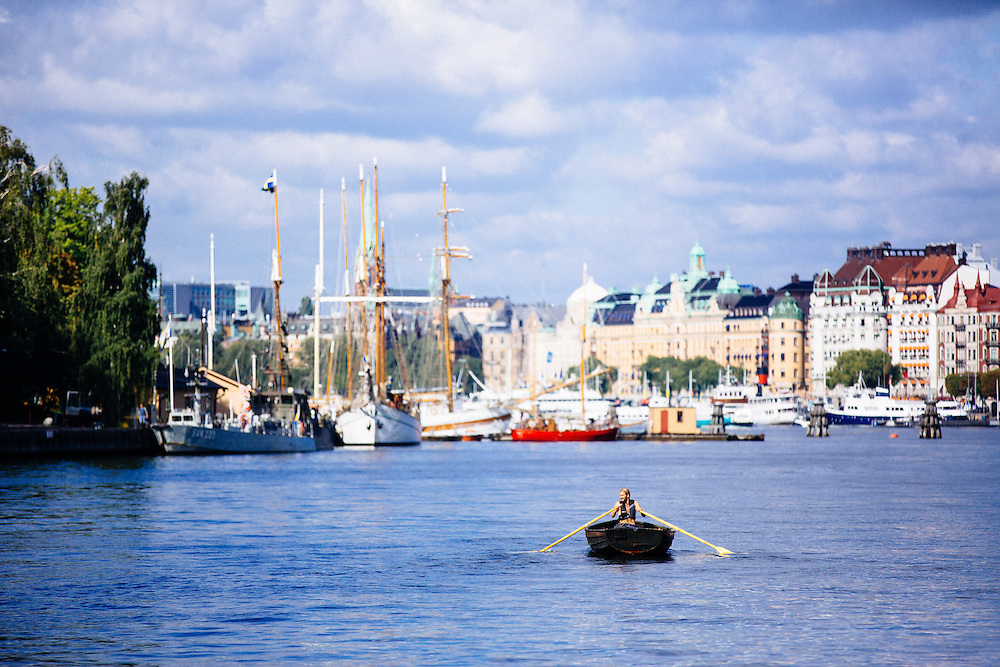 A man rows in the harbour of Stockholm